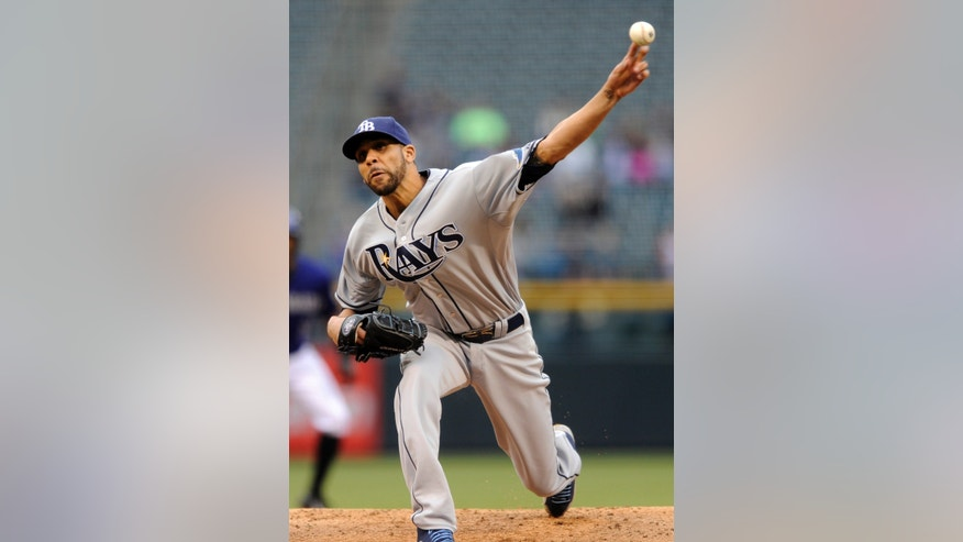 Tampa Bay Rays starting pitcher David Price throws to a Colorado Rockies batter during the first inning of a baseball game Saturday, May 4, 2013, in Denver. (AP Photo/Jack Dempsey)
