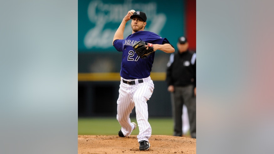 Colorado Rockies starting pitcher Jon Garland throws against the Tampa Bay Rays during the first inning of a baseball game Saturday, May 4, 2013, in Denver. (AP Photo/Jack Dempsey)