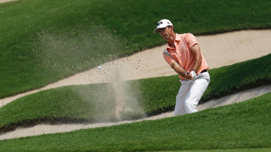 Wade Ormsby of Australia hit the ball at eighth hole during the third round of the Indonesian Masters golf tournament at Royale Golf Club in Jakarta, Indonesia, Saturday, May 4, 2013. (AP Photo/Achmad Ibrahim)