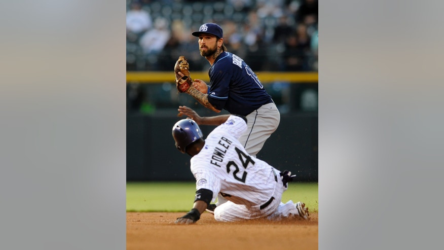 Tampa Bay Rays second baseman Ryan Roberts, top, forces out Colorado Rockies' Dexter Fowler (24) at second during the first inning of a baseball game on Friday, May 3, 2013, in Denver. (AP Photo/Jack Dempsey)