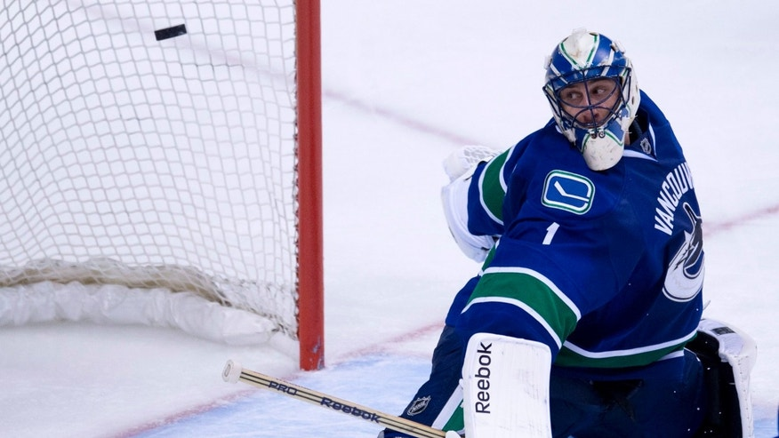 Vancouver Canucks goalie Roberto Luongo (1) watches as San Jose Sharks left wing Raffi Torres' shot goes past him during overtime of game two of an NHL Western Conference quarter-final playoff hockey series at Rogers Arena in Vancouver, British Columbia on Friday, May 3, 2013. (AP Photo/The Canadian Press, Jonathan Hayward)