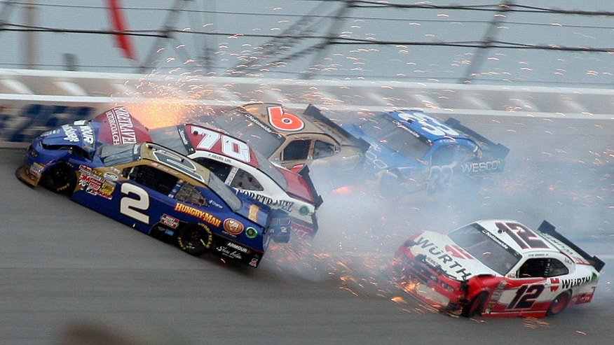 Brian Scott (2) crashes with Johanna Long (70), Trevor Bayne (6), Ty Dilon (33) and Sam Hornish Jr. (12) in Turn 3 during the NASCAR Nationwide Series auto race at the Talladega Superspeedway in Talladega, Ala., Saturday, May 4, 2013. (AP Photo/Dale Davis)