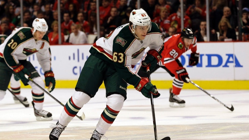 Minnesota Wild's Charlie Coyle (63) controls the puck against the Chicago Blackhawks during the first period of Game 2 of an NHL hockey Stanley Cup first-round playoff series in Chicago, Friday, May 3, 2013. (AP Photo/Nam Y. Huh)