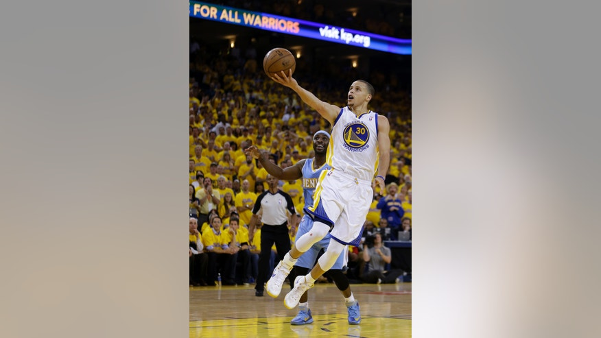 Golden State Warriors' Stephen Curry lays up a shot during the second half of Game 6 in a first-round NBA basketball playoff series against the Denver Nuggets on Thursday, May 2, 2013, in Oakland, Calif. (AP Photo/Ben Margot)