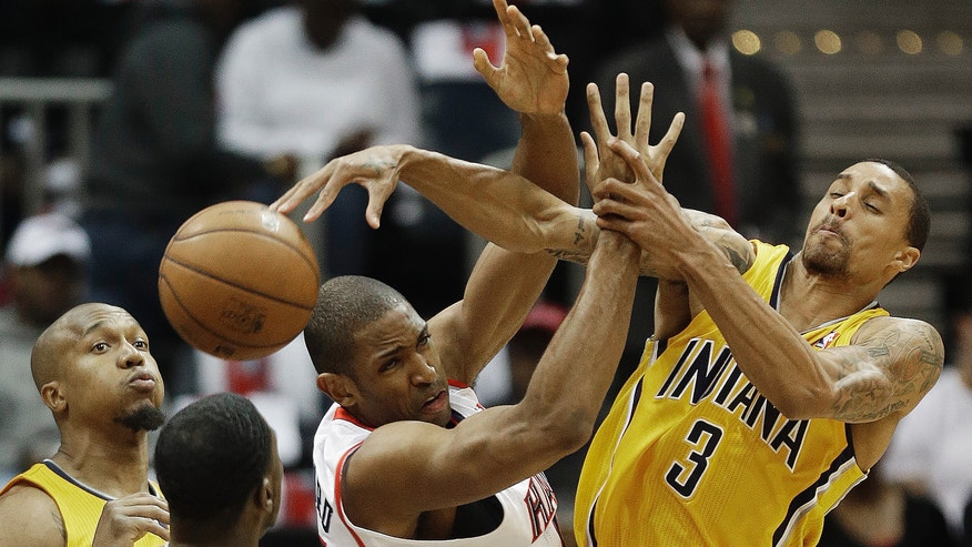 Atlanta Hawks center Al Horford (15) loses the ball as Indiana Pacers point guard George Hill (3) and Indiana Pacers shooting guard Lance Stephenson (1) defend in the first half of an NBA first-round playoff basketball game in Atlanta, Friday, May 3, 2013. (AP Photo/John Bazemore)