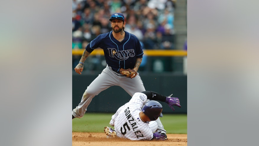 Tampa Bay Rays second baseman Ryan Roberts, top, avoids Colorado Rockies' Carlos Gonzalez as he slides into second base after being put out on the front end of a double play hit into by Troy Tulowitzki to end the fifth inning of an interleague baseball game in Denver on Sunday, May 5, 2013. (AP Photo/David Zalubowski)