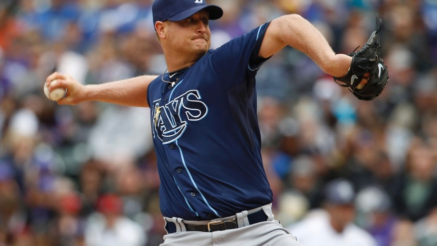 Tampa Bay Rays starting pitcher Alex Cobb works against the Colorado Rockies in the first inning of an MLB interleague baseball game in Denver on Sunday, May 5, 2013. (AP Photo/David Zalubowski)