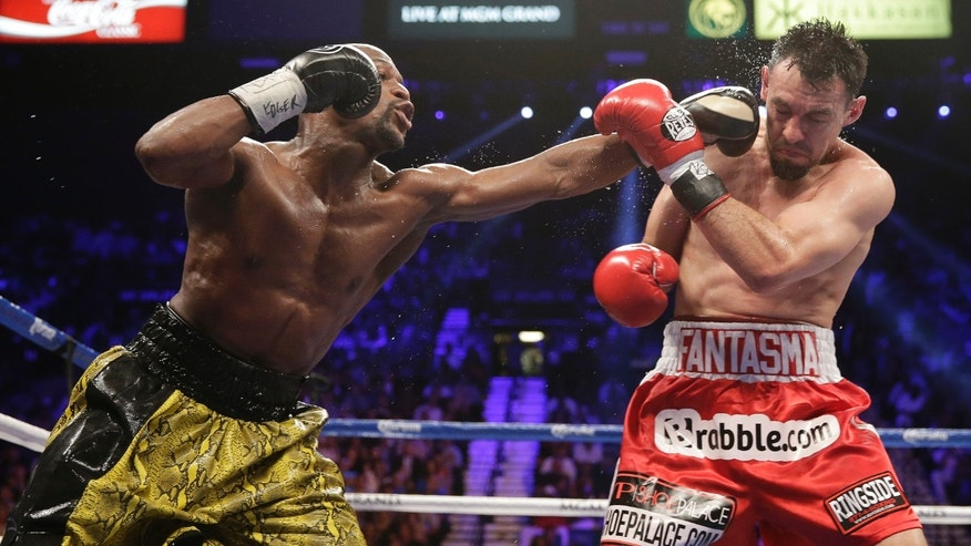 Floyd Mayweather Jr. lands a punch in the fifth round against Robert Guerrero during a WBC welterweight title fight, Saturday, May 4, 2013, in Las Vegas. Mayweather won by unanimous decision.  (AP Photo/Isaac Brekken)