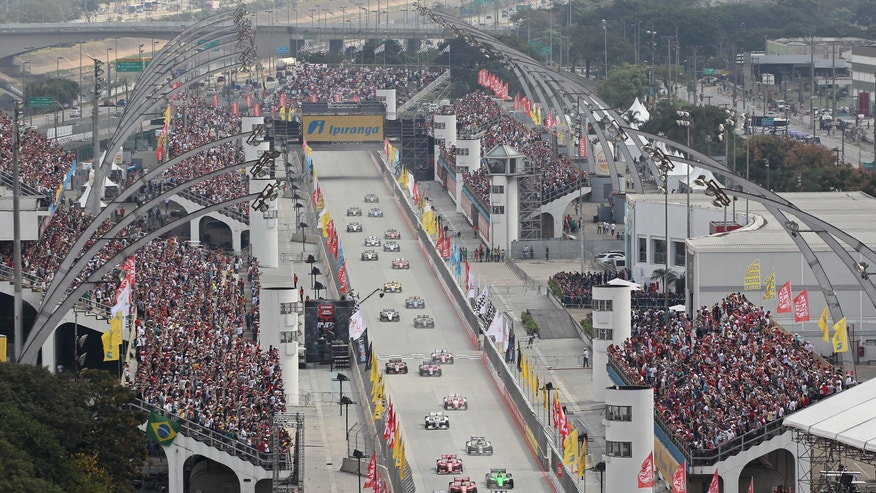 IndyCar driver Ryan Hunter-Reay, of the US, leads the pack  during the start of the IndyCar's Sao Paulo 300 in Sao Paulo, Brazil, Sunday May 5, 2013. (AP Photo/Andre Penner)
