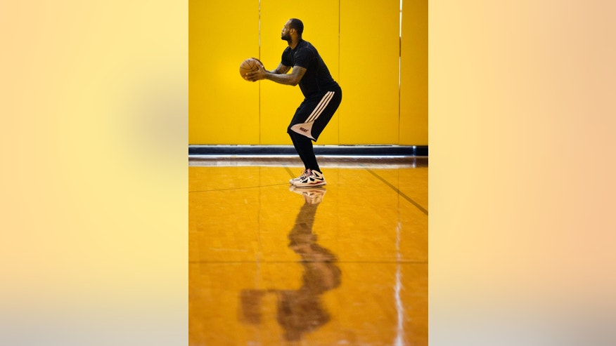 Miami Heat's LeBron James shoots during an NBA basketball practice session, Saturday, May 4, 4013 in Miami.  A formal announcement is planned Sunday saying James will win the NBA's Most Valuable Player award for a fourth time. (AP Photo/J Pat Carter)