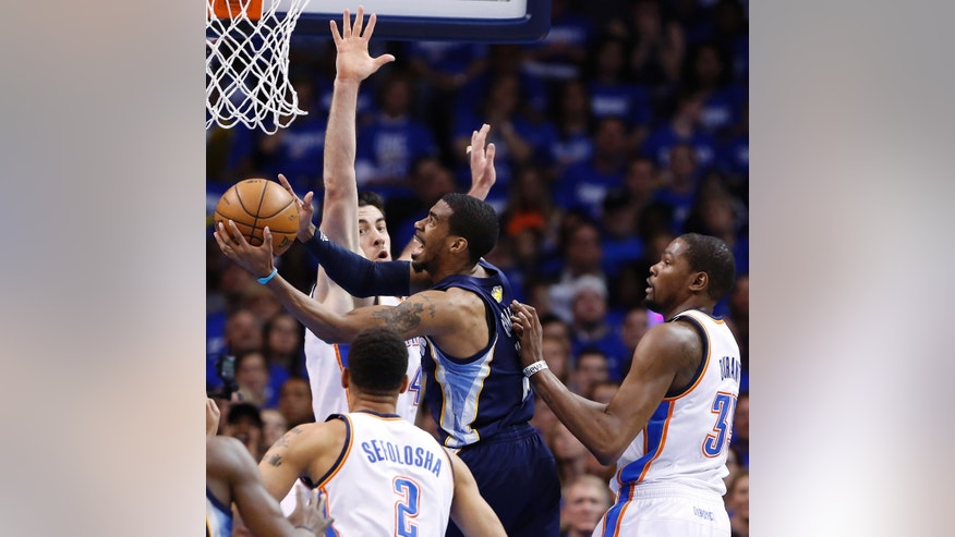 Memphis Grizzlies Tony Allen goes to the basket as Oklahoma City Thunder's Nick Collison, back, defends and Kevin Durant (35)and Thabo Sefolosha (2) look on during the second quarter of Game 1 of their Western Conference Semifinals NBA basketball playoff series in Oklahoma City, Sunday, May 5, 2013.  (AP Photo/Alonzo Adams)