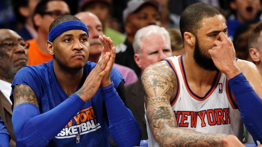 New York Knicks forward Carmelo Anthony and center Tyson Chandler (6) sit on the bench in the second half of Game 1 of their NBA basketball playoff series in the Eastern Conference semifinals against the Indiana Pacers at Madison Square Garden in New York, Sunday, May 5, 2013. The Pacers won 102-95. (AP Photo/Kathy Willens)