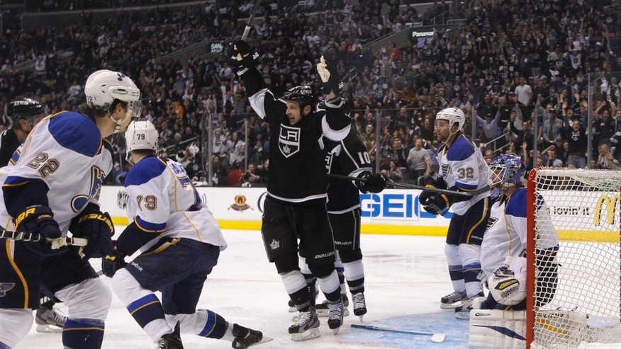 Los Angeles Kings' Kyle Clifford, center, celebrates a goal by Slava Voynov, of Russia, during the second period in Game 3 of a first-round NHL hockey Stanley Cup playoff series against the St. Louis Blues in Los Angeles, Saturday, May 4, 2013. (AP Photo/Jae C. Hong)