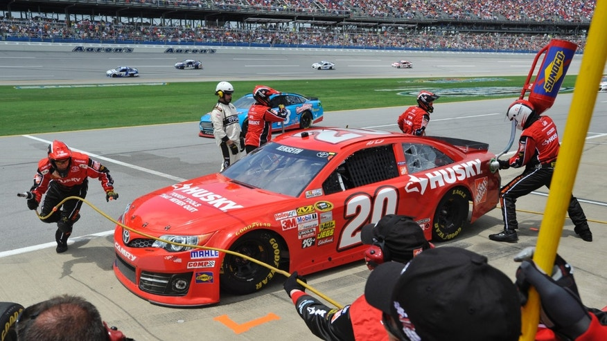 NASCAR Sprint Cup Series driver Matt Kenseth gets service during the Aaron's 499 auto race at Talladega Superspeedway in Talladega, Ala., Sunday, May 5, 2013. (AP Photo/Rainier Ehrhardt)