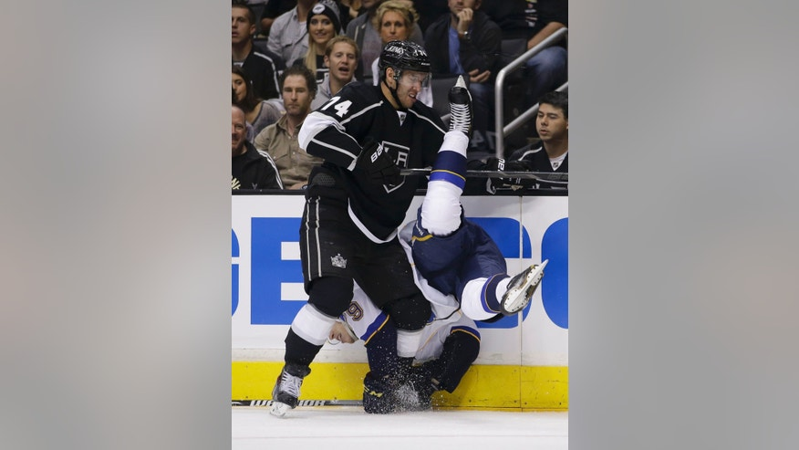St. Louis Blues' Adam Cracknell, right, is checked by Los Angeles Kings' Dwight King during the first period in Game 3 of a first-round NHL hockey Stanley Cup playoff series n Los Angeles, Saturday, May 4, 2013. (AP Photo/Jae C. Hong)