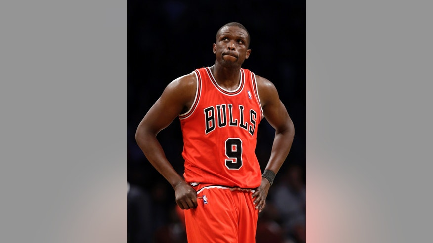 Chicago Bulls forward Luol Deng (9) reacts in the second half of Game 5 of their first-round NBA basketball playoff series against the Brooklyn Nets, Monday, April 29, 2013, in New York. The Nets won 110-91. (AP Photo/Kathy Willens)