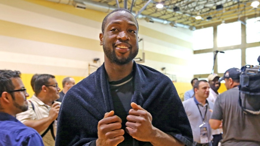 Miami Heat's Dwyane Wade smiles after team practice at American Airlines Arena in Miami on Friday, May 3, 2013. (AP Photo/El Nuevo Herald, Al Diaz)  MAGS OUT NO SALES