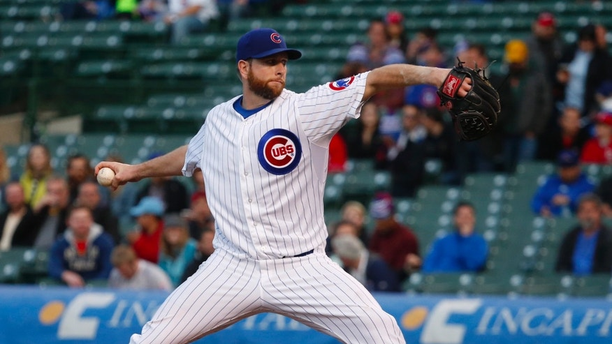 Chicago Cubs starting pitcher Scott Feldman delivers during the first inning of a baseball game against the Texas Rangers, Monday, May 6, 2013, in Chicago. (AP Photo/Charles Rex Arbogast)