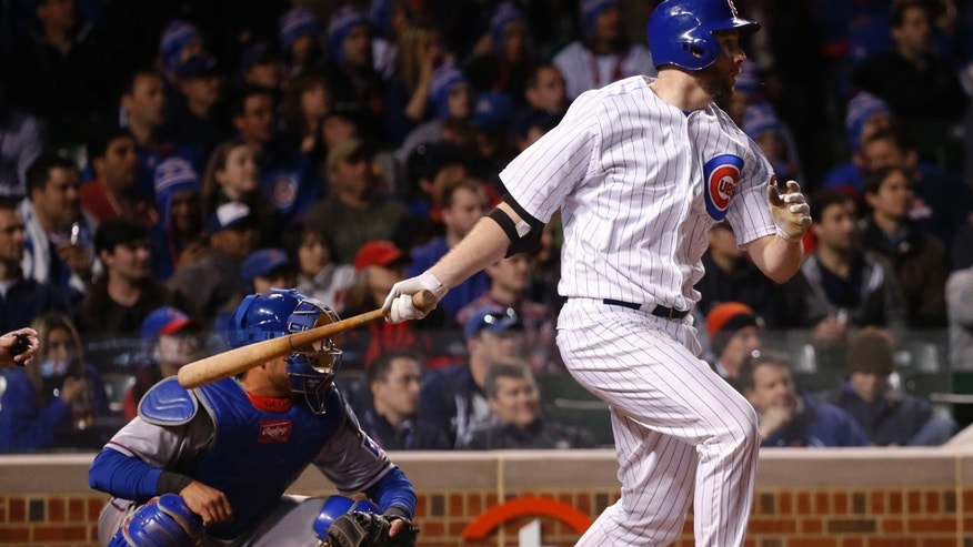 Chicago Cubs' Scott Feldman hits an RBI single off Texas Rangers starting pitcher Nick Tepesch, scoring Luis Valbuena, with two outs in the fourth inning of a baseball game, Monday, May 6, 2013, in Chicago. (AP Photo/Charles Rex Arbogast)