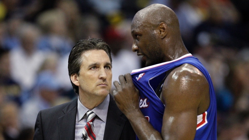Los Angeles Clippers' Lamar Odom, right, talks to Los Angeles Clippers coach Vinny Del Negro, during the first half of Game 6 in a first-round NBA basketball playoff series in Memphis, Tenn., Friday, May 3, 2013. (AP Photo/Danny Johnston)