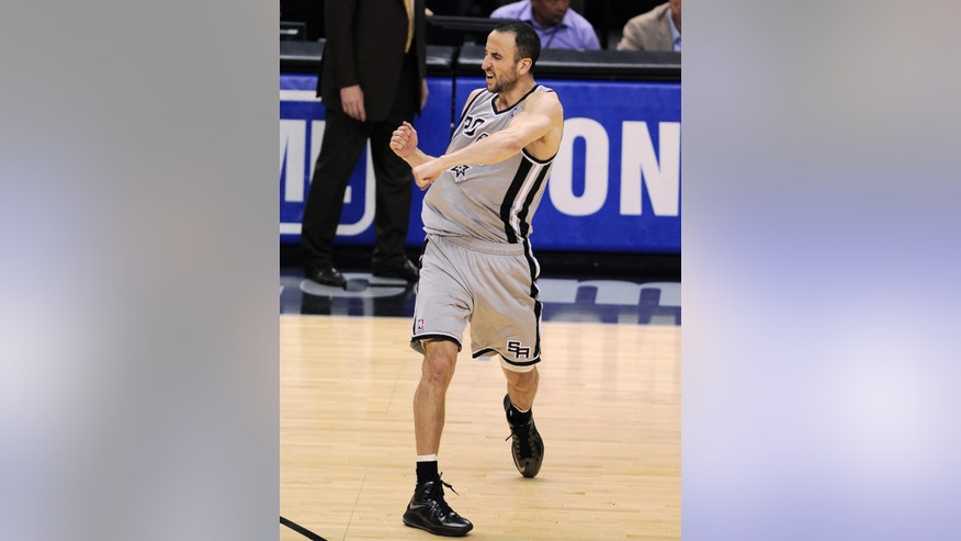San Antonio Spurs' Manu Ginobili, of Argentina, reacts after making the winning shot in the last seconds of Game 1 of the Western Conference semifinal NBA basketball playoff series against the Golden State Warriors, Monday, May 6, 2013, in San Antonio. San Antonio won 129-127 in double overtime. (AP Photo/Darren Abate)