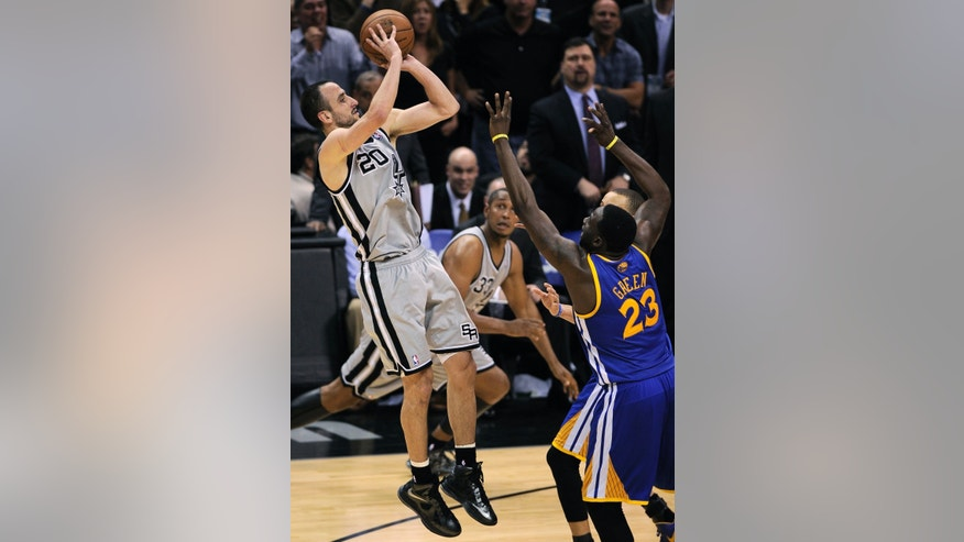San Antonio Spurs' Manu Ginobili, left, of Argentina, shoots over Golden State Warriors' Draymond Green during the second half of Game 1 of the Western Conference semifinal NBA basketball playoff series, Monday, May 6, 2013, in San Antonio. San Antonio won 129-127 in double overtime. (AP Photo/Darren Abate)