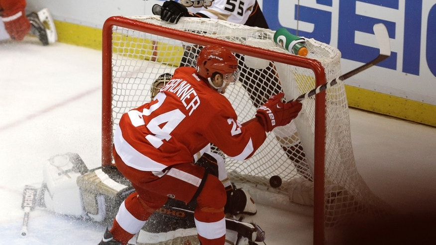 Detroit Red Wings center Damien Brunner (24), of Switzerland, scores the game winning goal against Anaheim Ducks goalie Jonas Hiller (1), of Switzerland, in overtime of Game 4 of a first-round NHL hockey Stanley Cup playoff series in Detroit, Monday, May 6, 2013. Detroit won 3-2. (AP Photo/Paul Sancya)