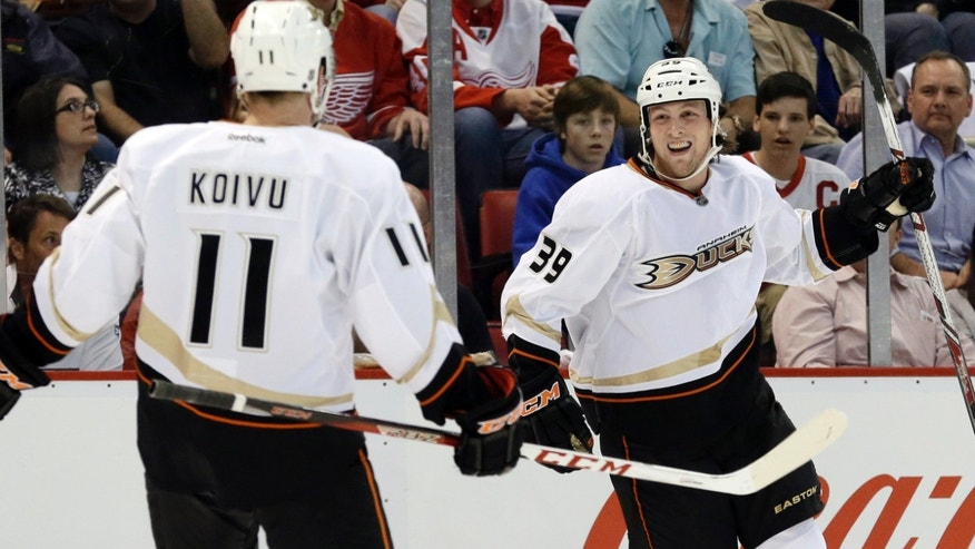 Anaheim Ducks left wing Matt Beleskey (39) celebrates his goal against the Detroit Red Wings with Saku Koivu (11), of Finland, in the first period of Game 4 of a first-round NHL hockey Stanley Cup playoff series in Detroit, Monday, May 6, 2013. (AP Photo/Paul Sancya)