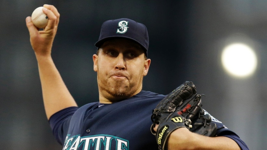 Seattle Mariners starting pitcher Aaron Harang delivers during the first inning of an interleague baseball game against the Pittsburgh Pirates in Pittsburgh, Tuesday, May 7, 2013. (AP Photo/Gene J. Puskar)