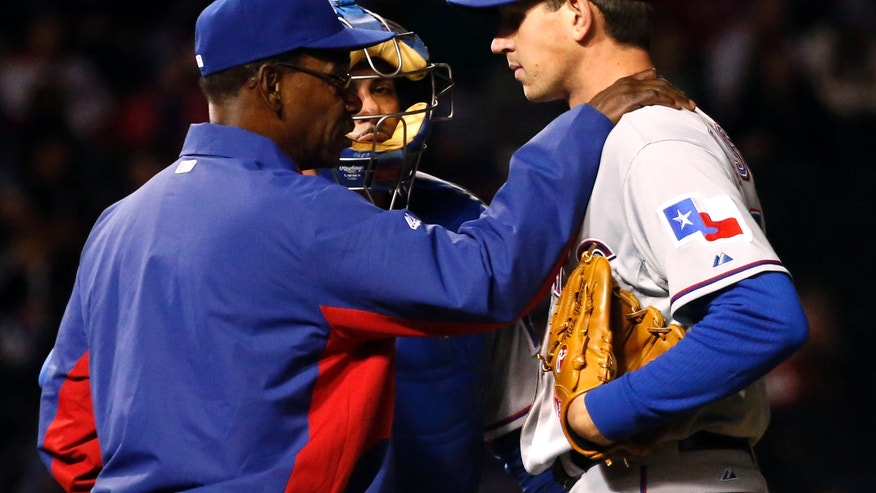 Texas Rangers manager Ron Washington, left, talks to starting pitcher Nick Tepesch, right, as catcher Geovany Soto listens during the fourth inning of a baseball game against the Chicago Cubs, Monday, May 6, 2013, in Chicago. (AP Photo/Charles Rex Arbogast)