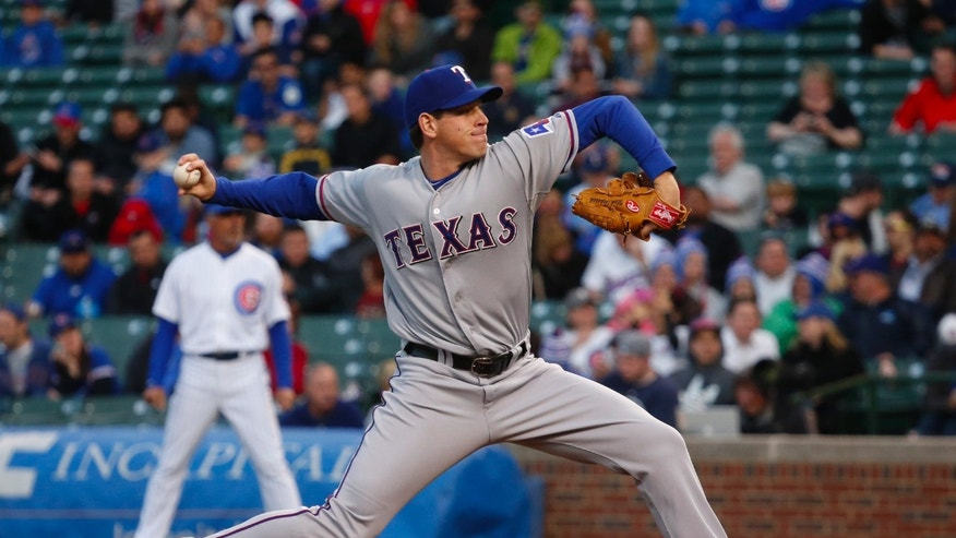 Texas Rangers starting pitcher Nick Tepesch delivers during the first inning of a baseball game against the Chicago Cubs, Monday, May 6, 2013, in Chicago. (AP Photo/Charles Rex Arbogast)
