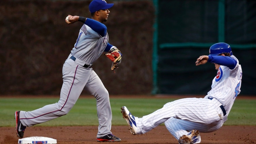 Texas Rangers shortstop Elvis Andrus, left, is unable to turn the double play as he forces Chicago Cubs' Anthony Rizzo at second and misses Alfonso Soriano at first during the first inning of a baseball game, Monday, May 6, 2013, in Chicago. (AP Photo/Charles Rex Arbogast)