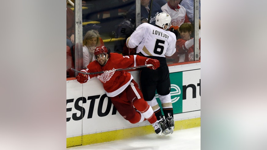 Anaheim Ducks defenseman Ben Lovejoy (6) checks Detroit Red Wings right wing Patrick Eaves (17) in the third period of Game 4 of a first-round NHL hockey Stanley Cup playoff series in Detroit, Monday, May 6, 2013. (AP Photo/Paul Sancya)