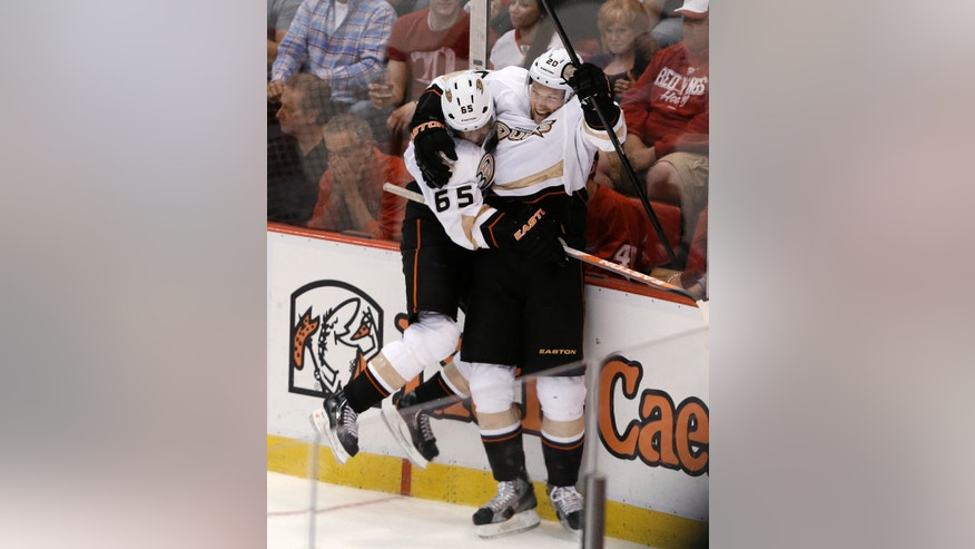 Anaheim Ducks right wing Emerson Etem (65) celebrates his goal with David Steckel (20) against the Detroit Red Wings in the third period of Game 4 of a first-round NHL hockey Stanley Cup playoff series in Detroit, Monday, May 6, 2013. (AP Photo/Paul Sancya)