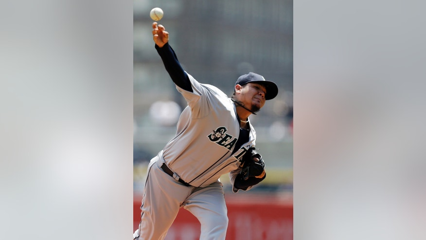 Seattle Mariners starting pitcher Felix Hernandez delivers during the first inning of an interleague baseball game against the Pittsburgh Pirates in Pittsburgh, Wednesday, May 8, 2013. (AP Photo/Gene J. Puskar)