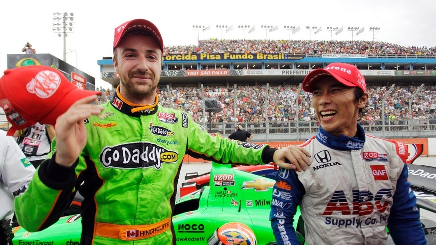 FILE - In this May 5, 2013, file photo. IndyCar drivers James Hinchcliffe, left of Canada, and Takuma Sato, of Japan, celebrate after the IndyCar Sao Paulo 300 auto race in Sao Paulo, Brazil. IndyCar heads to its signature event in Indianapolis with some momentum and a wide-open feel after Hinchcliffe's last-turn pass of Takuma Sato for victory in Brazil. (AP Photo/Nelson Antoine, File)