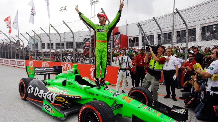 FILE - In this May 5, 2013, file photo, IndyCar driver James Hinchcliffe, of Canada, celebrates on the top of his car after winning the IndyCar Sao Paulo 300 in Sao Paulo, Brazil. IndyCar heads to its signature event in Indianapolis with some momentum and a wide-open feel after Hinchcliffe's last-turn pass of Takuma Sato for victory in Brazil. (AP Photo/Nelson Antoine, File)