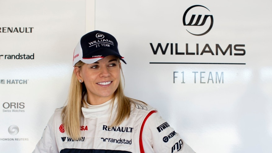 In this photo taken on Jan. 29, 2012, and released by the Williams F1 Team on Wednesday, May 8, 2013, Susie Wolff poses for a photo at the Monte Blanco Circuit in Spain. From the moment development driver Susie Wolff first got into her Williams car, she has heard the snickers from those who questioned whether women belong in Formula One. But rather than let the doubters discourage her, she said is focused on achieving her dream of becoming the first women on the grid in more than three decades. (AP Photo/Williams F1 Team, Malcolm Griffiths)