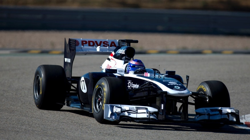 In this photo taken on Jan. 30, 2012, and released by the Williams F1 Team on Wednesday, May 8, 2013, Susie Wolff drives a Williams race car at the Monte Blanco Circuit in Spain. From the moment development driver Susie Wolff first got into her Williams car, she has heard the snickers from those who questioned whether women belong in Formula One. But rather than let the doubters discourage her, she said is focused on achieving her dream of becoming the first women on the grid in more than three decades. (AP Photo/Williams F1 Team, Malcolm Griffiths)