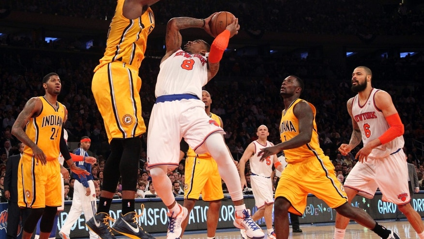 Indiana Pacers' Roy Hibbert, second from left, blocks New York Knicks' J.R. Smith from going to the basket in the second half of Game 2 of their NBA basketball playoff series in the Eastern Conference semifinals at Madison Square Garden in New York, Tuesday, May 7, 2013. The Knicks won 105-79. (AP Photo/Mary Altaffer)