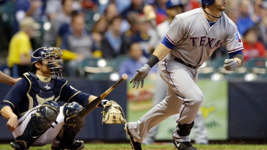 Texas Rangers' Mitch Moreland followed through on his home run during the third inning of a baseball game against the Milwaukee Brewers Wednesday, May 8, 2013, in Milwaukee. (AP Photo/Morry Gash)