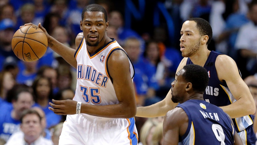 Memphis Grizzlies forward Tayshaun Prince, right rear, and Tony Allen (9) guard Oklahoma City Thunder forward Kevin Durant (35) during the first half of Game 2 in their Western Conference semifinal NBA basketball playoff series Tuesday, May 7, 2013, in Oklahoma City. (AP Photo/Tony Gutierrez)