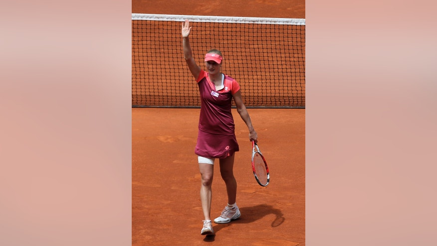 Ekaterina Makarova from Russia celebrates her victory in the match against Victoria Azarenka from Belarus at the Madrid Open tennis tournament, in Madrid, Wednesday, May 8, 2013. (AP Photo/Andres Kudacki)