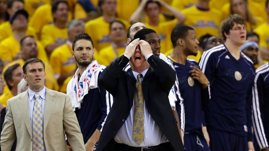 Denver Nuggets head coach George Karl,  center, reacts in the closing seconds of a 92-88 loss to the Golden State Warriors during Game 6 in a first-round NBA basketball playoff series in Oakland, Calif., Thursday, May 2, 2013. (AP Photo/Marcio Jose Sanchez)