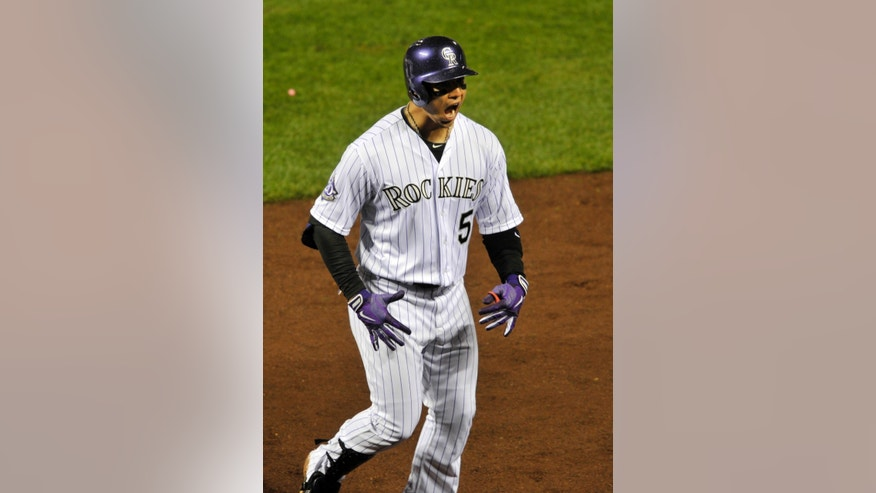 Colorado Rockies' Carlos Gonzalez celebrates his two-run home run against the New York Yankees during the sixth inning of a baseball game on Tuesday, May 7, 2013, in Denver. (AP Photo/Jack Dempsey)