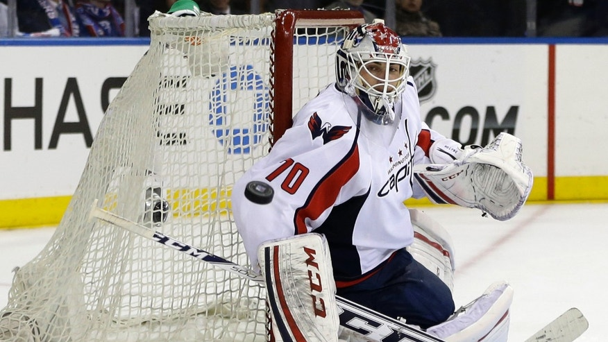 Washington Capitals goalie Braden Holtby (70) makes a save in the second period of Game 4 of their first-round NHL Stanley Cup playoff series against the New York Rangers in New York, Wednesday, May 8, 2013. (AP Photo/Kathy Willens)