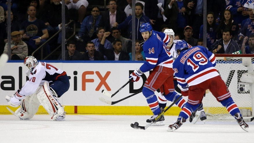 New York Rangers defenseman Michael Del Zotto (4) watches center Brad Richards (19) shoot and score as Washington Capitals goalie Braden Holtby (70) watches out of position in the first period of Game 4 of their first-round NHL hockey Stanley Cup playoff series in New York, Wednesday, May 8, 2013. (AP Photo/Kathy Willens)