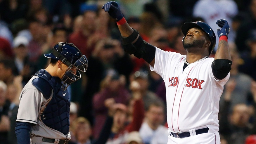 Boston Red Sox's David Ortiz, right, celebrates his solo home run as Houston Astros' Jason Castro looks down in the third inning of a baseball game in Boston, Thursday, April 25, 2013. (AP Photo/Michael Dwyer)