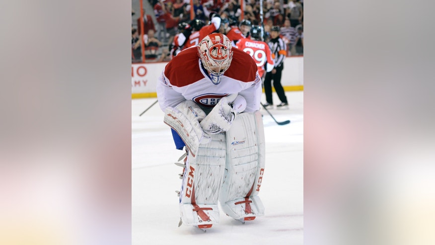 Montreal Canadiens' Carey Price skates away from the net after a goal by the Ottawa Senators during the third period of Game 4 of an NHL hockey Stanley Cup playoff series in Ottawa, Ontario, on Tuesday, May 7, 2013. The Senators won 3-2 in overtime. (AP Photo/The Canadian Press, Sean Kilpatrick)