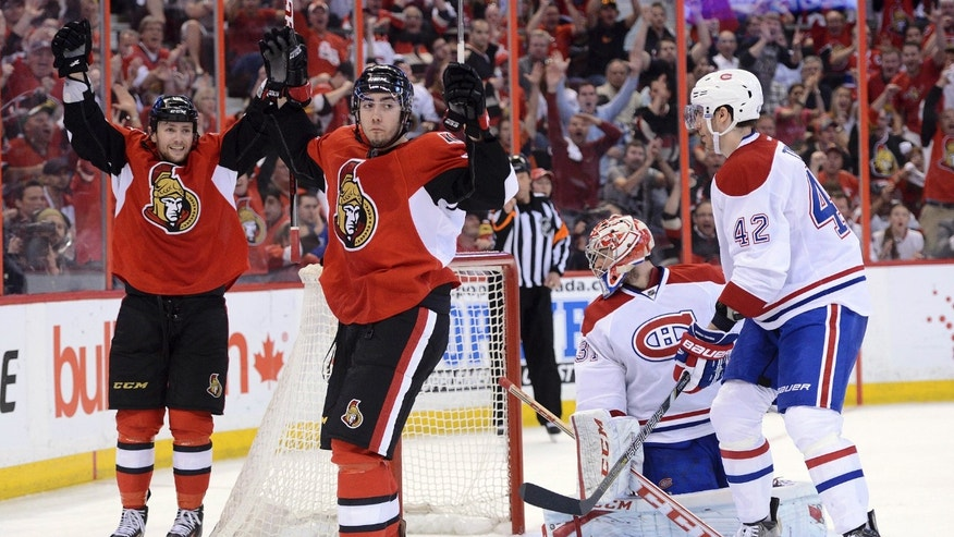 Ottawa Senators' Mika Zibanejad, second from left, celebrates his goal alongside teammate Zack Smith as Montreal Canadiens' Carey Price looks back into the net alongside teammate Jarred Tinordi during the third period of Game 4 of an NHL hockey Stanley Cup playoff series in Ottawa, Ontario, on Tuesday, May 7, 2013. (AP Photo/The Canadian Press, Sean Kilpatrick)